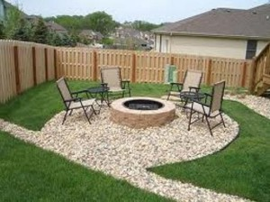 exterior-enchanting-idea-of-the-fire-pit-made-of-stone-on-stone-ground-shaped-into-round-theme-surrounding-by-modern-chairs-awesome-exterior-features-warming-up-for-cool-fire-pit-ideas-546x409